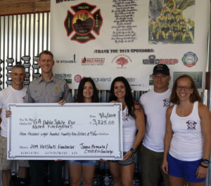 Donation check presented to the Georgia Public Safety Memorial Committee in honor of the Granite Mountain Hot Shots. Left is Andy Mccann; Lt Judd Smith, Vice Chairman of the Georgia Public Safety Memorial Committee; Jessica Andres; Jamie Armenta; Nicholas Armenta and Dani Walsh.